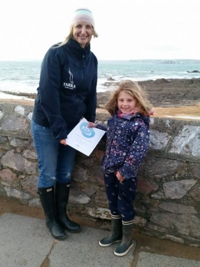 Owner Shelley Robinson-Major receiving an award from Ella on behalf of Plastic Clever Salcombe